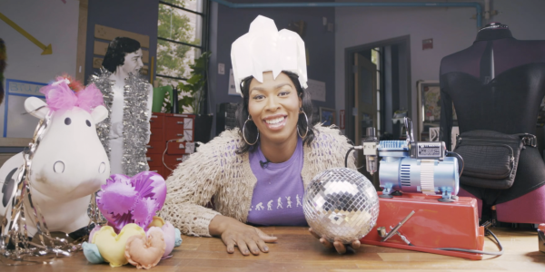LeeLee James sits in the BTU lab wearing a funny white hat and holding a disco ball