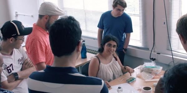 Mirela Alistar talks to students in her Personal Biochips class.