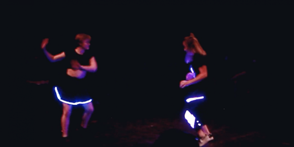 dancers wearing interactive LED costumes