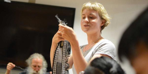 Sandra Wirtanen shows a weaving from her weaving residency.