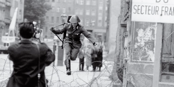 Soldier jumping over razor wire