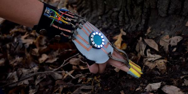 Photo of the Hand-Substrate Interface, a wearable moisture sensor for mushroom foragers designed by Jen Liu