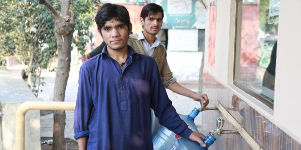 men getting water from Water ATM