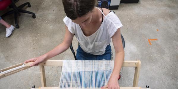 Laura Devendorf working on loom