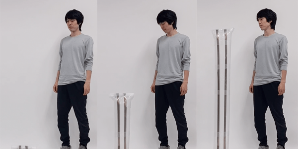 Ryo Suzuki stands next to LiftTiles in three different stages of expansion.