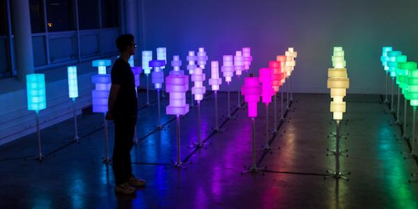 Field of 36 colored light towers in room.