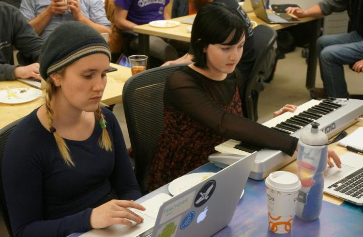 Annie Kelley works on a keyboard attached to her computer during the MakeCode workshop.