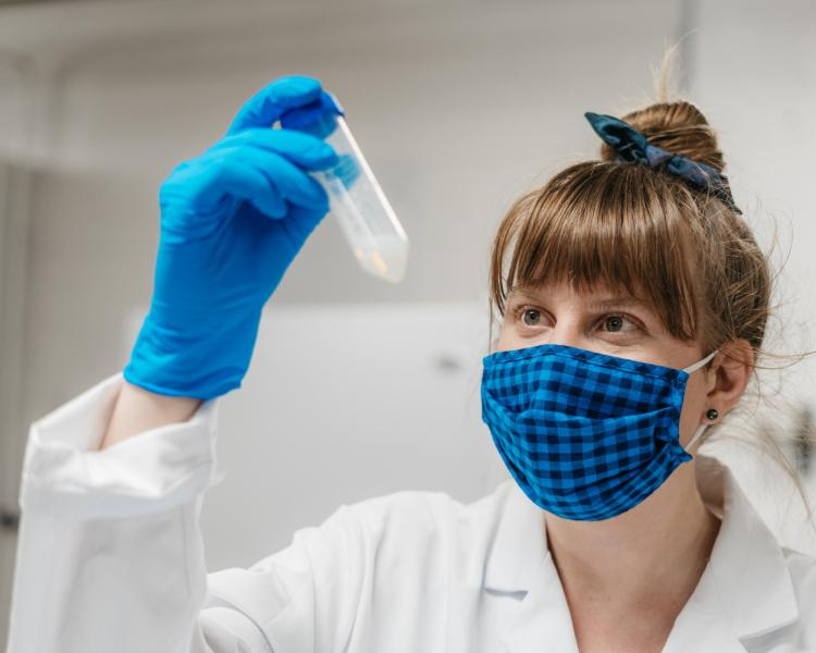 Fiona Bell inspects nanocoating in test tube