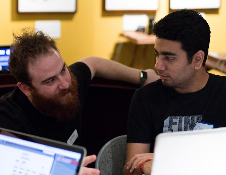 Assistant Professor Ben Shapiro helps a student.