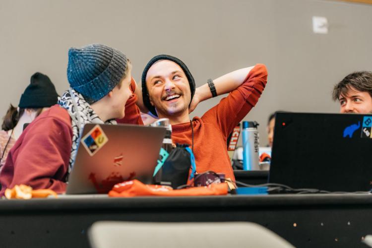 Alex Fiel enjoys a laugh with TAM student Anna Lynton.