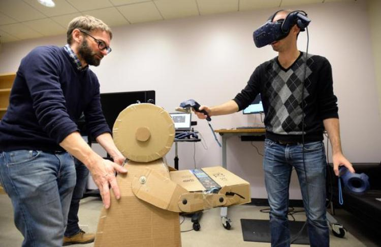 ATLAS Institute graduate student Peter Gyory, right, demonstrates the new 3D design platform he is developing with THING Lab Director Daniel Leithinger.