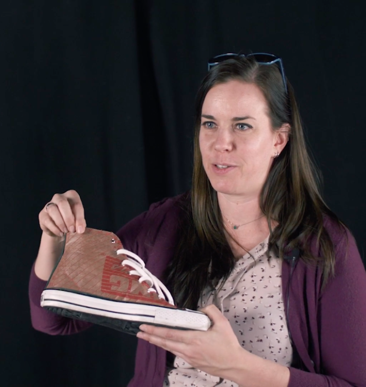 Photo of Mel Plett with a shoe made by one of her wearables students