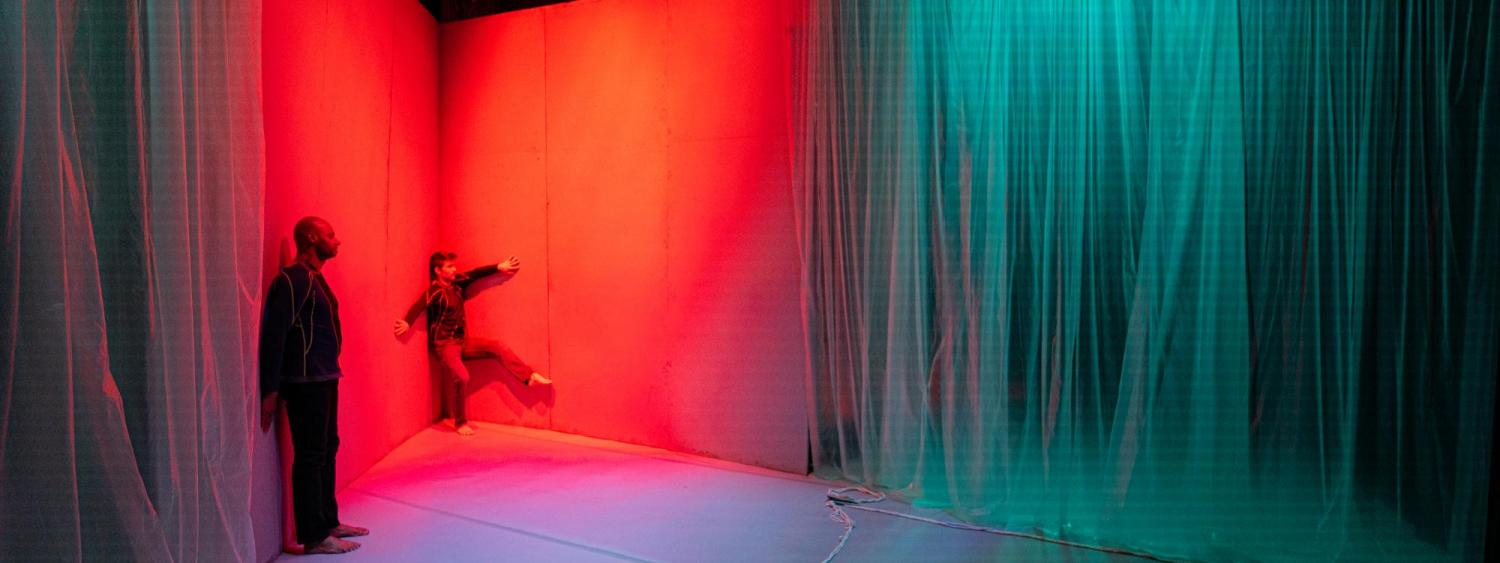 dancers leaning on walls triggered red color lighting