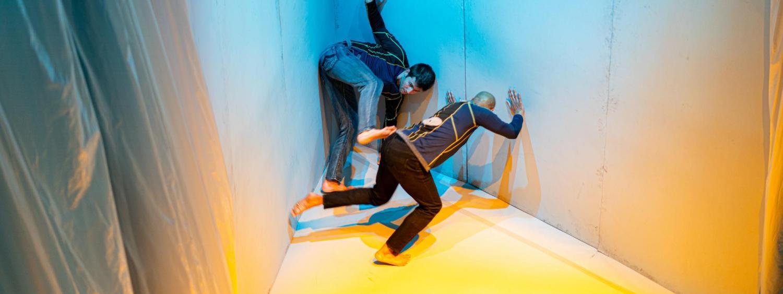 dancers between angled walls