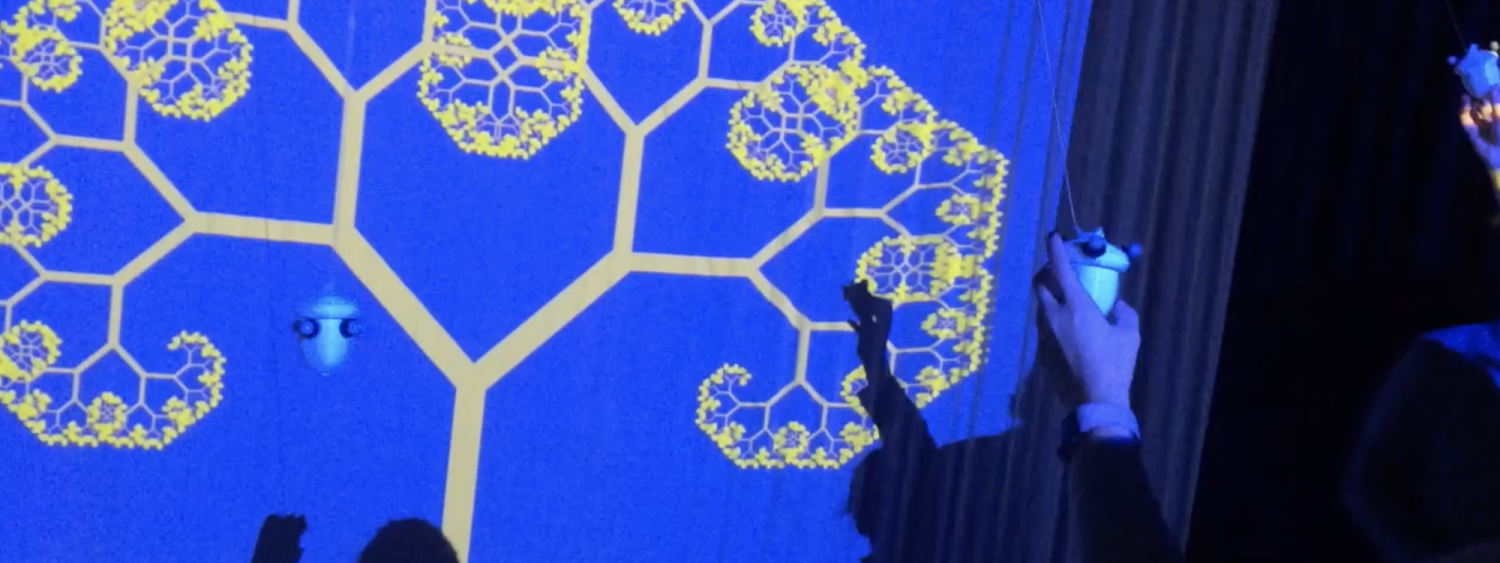 a woman moving objects that affecting parametric changes of a projected geometric tree