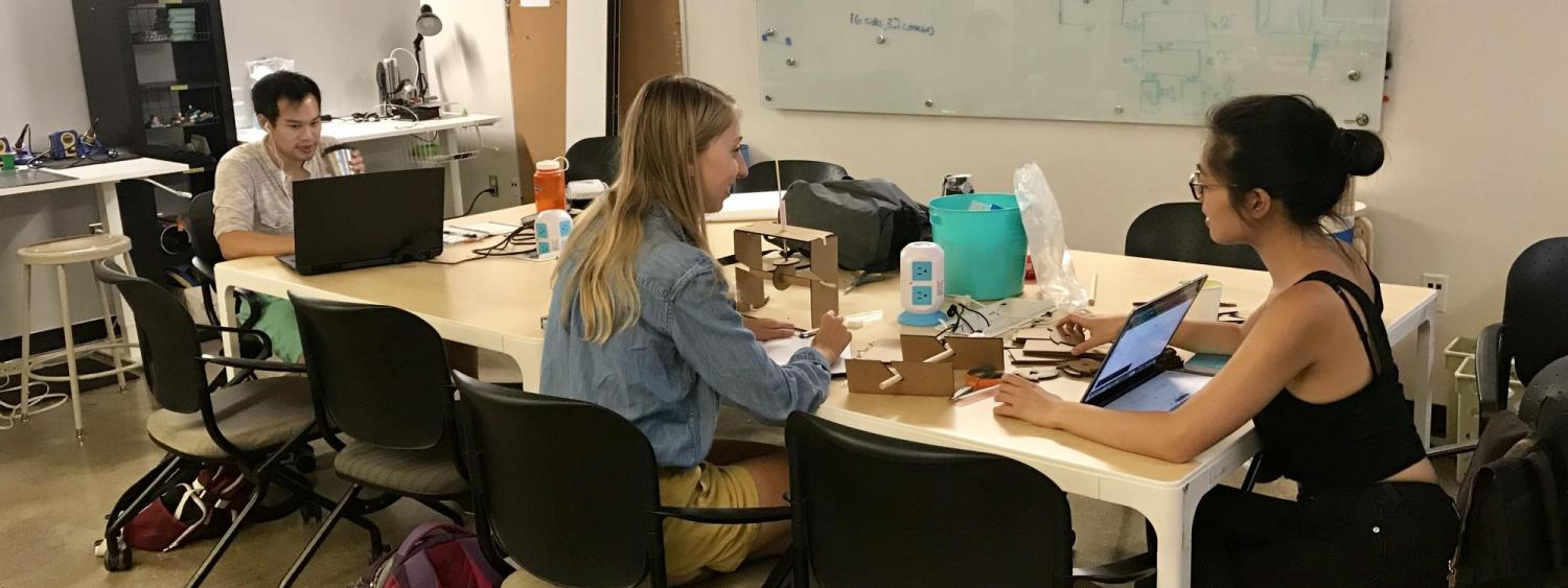 Photo of students working in the Grad Lab