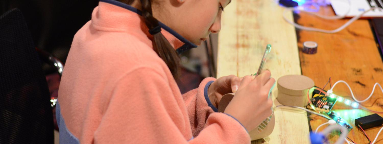 girl working with microcontrollers