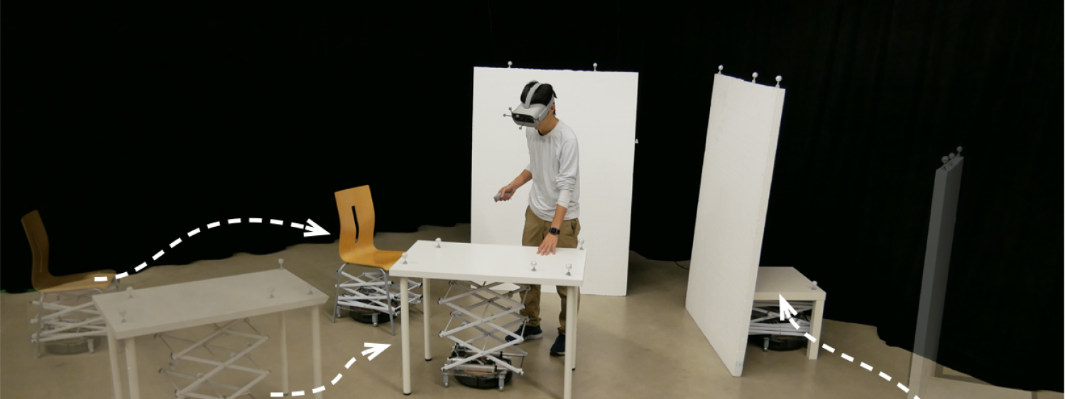 researcher in a room wearing VR goggles