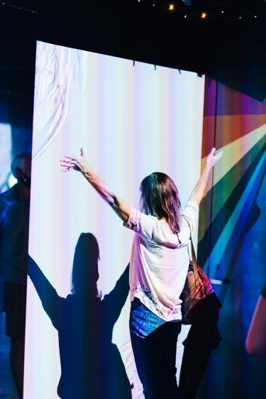 woman dancing in rainbow room