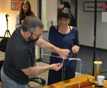 Teachers building a wire sculpture