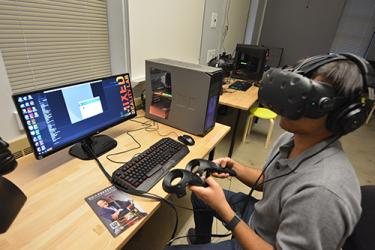 Student uses Virtual reality headset in the new Mixed Reality Lab