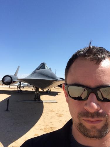 Nick Conlon in front of an SR-71 Blackbird, a reconnaissance jet once operated by the US Air Force and NASA.