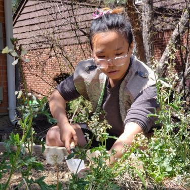 Shanel Wu working in a garden