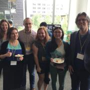 Lea Albaugh surrounded by Laura Devendorf and others at the ACM Symposium on Computational Fabrication