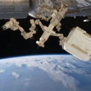 Robot arm hovering above Earth.
