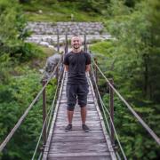 Alex Fiel on a suspension bridge.