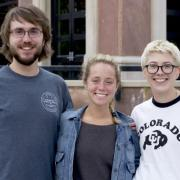 Brady Risendal, Marla Bernstein, and Meridith Richter stand outside the Roser ATLAS building.