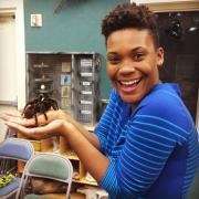 Kaylee Arnold holds a tarantula at an outreach event she led in Athens, Georgia.