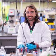 Carson Bruns in his Laboratory for Emergent Nanomaterials.