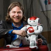 Photo of Dan Szafir with robot