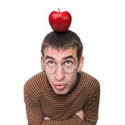 Photo of a man with an apple on his head