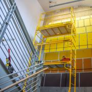 """Looking from below to """"The Golden Rectangle"""" installation, with scaffolding in front of it."""