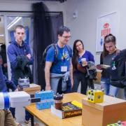 Fetch, a four-foot-tall robot is shown to attendees of the ATLAS Research Showcase.