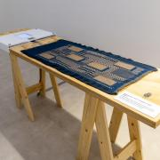 A Fabric that Remembers displayed on a table at the Centre for Heritage, Arts and Textile in Hong Kong