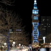 Denver's Daniels and Fisher tower lit up at night.