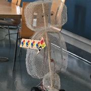 Robot made from chicken wire in the BTU Lab is a tour guide for the lab.