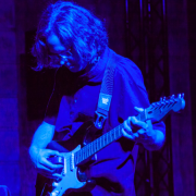 Michael Theodore plays electric guitar in a sold-out show at Issue Project Room in Brooklyn on June 26.