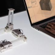 Photo of ShapeBots next to laptop