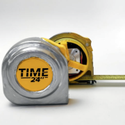 A tape measure clock with a view of the outside and inside.