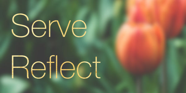 Learn, Serve, Reflect, Repeat in front of flowers