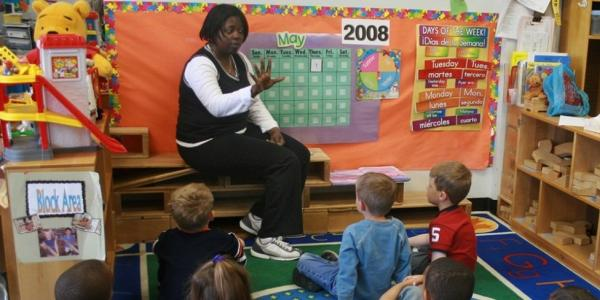 teacher gives lesson to K-12 students