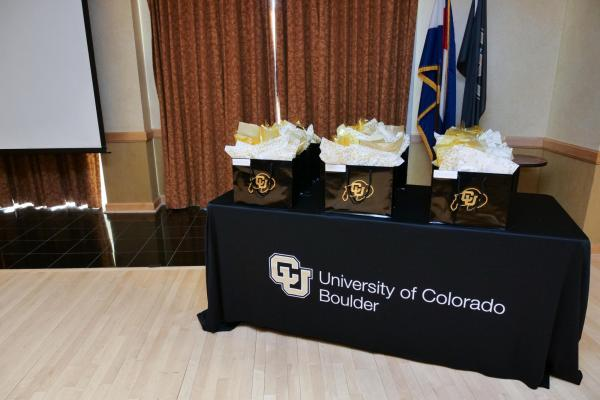 Award gift bags on a CU Boulder table