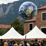 Beach Ball textured as earth is bounced in a crowd