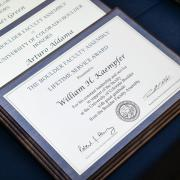 Leadership award winners plaques on a blue tablecloth