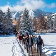 Students walking on campus in the snow
