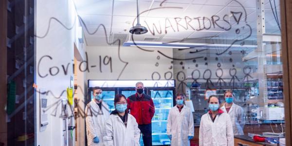 Cole Hager, Lina Tat, Biofrontiers Institute Director Roy Parker, Morgan Fink, lab director Tassa Saldi and Megan Winter in the saliva testing lab
